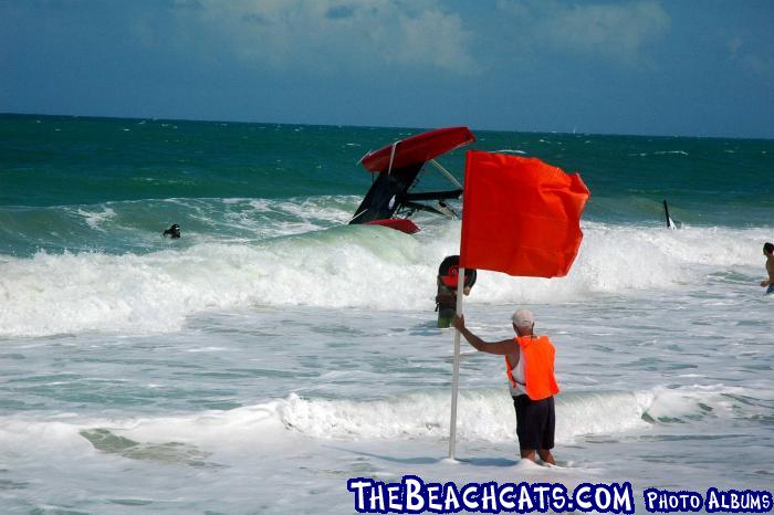 Team Lupe Tortilla Flying Phantom Gets Rolled in the Surf photo copyright TheBeachcats.com