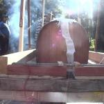 pic024-Slowly and carefully torture the ply into the hull shape.