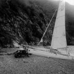 """(solo) hauling out """"Whisk"""" on the beach at Goat Harbor, Catalina Island"""