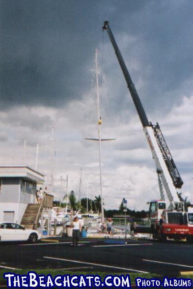 Stars and Stripes getting her new 90' carbon fiber mast at Cape Coral Yacht Club, FL. 10/03