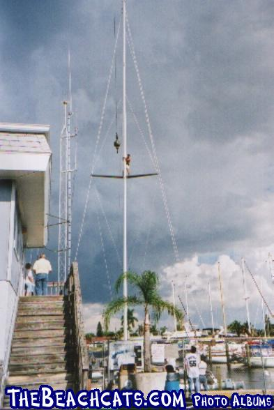 Mark, the owner, finally gets to unhook the mast from the crane. Note the 18' spreaders.