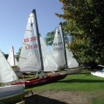 some of the boats at rest on a grassy beach.